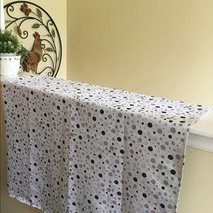 Grey polka dot shower curtain.